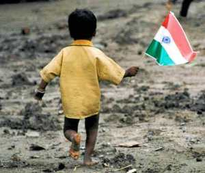 a-homeless-young-boy-waves-the-indian-flag